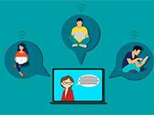 Uma tela de computador mostra uma pessoa, possivelmente uma professora, conversando com três estudantes,que acessam a aula através de seus computadores